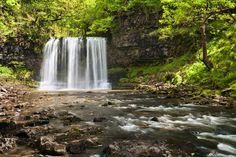 Visitors to the Brecon Beacons can walk behind the beautiful Sgwd-yr-Eira (the Snow Waterfall) in Wales