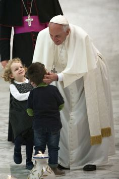 Pope Francis greets children during meeting with Catholic pilgrimage association at Vatican