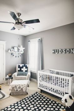 soft gray paint idea with black and white decor for boy's nursery room