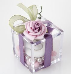 Engaging:  High quality Plexiglas small box with two different varieties of confetti candies, including pair of sugar confetti rings, silk ribbon, hand-made flower composition.