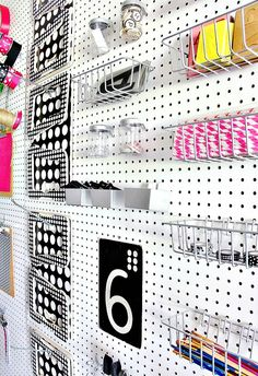 Use a peg board wall to organize craft supplies.  Hooks, baskets and clipboards keep everything in place!