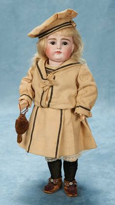 """German Bisque Closed Mouth Child by Kestner  15"""" (38 cm.) Bisque socket head,brown glass sleep eyes plaster pate,composition and wooden eight-loose-ball-jointed body with straight wristMarks: 10. Kestner,circa 1885."""