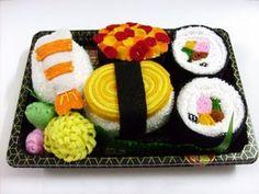 Bath towels arranged like a sushi platter