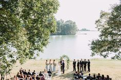 Lake, river, waterfront wedding ceremony. Floral arch, floral arbor, outdoor wedding, blue wedding, simple wedding, september wedding, bride and groom, wedding day photography