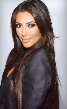 Kim Kardashian. long brunette hair