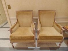 Lot 499 - A pair of Italian Neoclassical style antiqued distressed wood and parcel gilt upholstered Bergere,