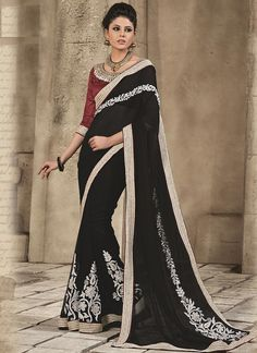 Young and vivacious is the perfect description for this refreshing black georgette party wear saree. This gleaming party wear saree is enriched with foliage patterns , motif work, patch border work an...