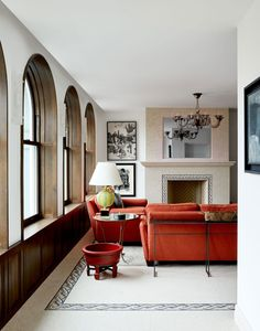A small, airy living room in an NYC triplex penthouse, designed by Alexander Gorlin Architects. Home Living Room, Living Room Decor, Manhattan Penthouse, Orange Sofa, Interior And Exterior, Interior Design, Arched Windows, Architectural Digest, Living Room Inspiration