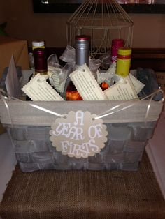 Wedding gift. Year of firsts basket!! Give a bottle of wine for each first that might come that year :)