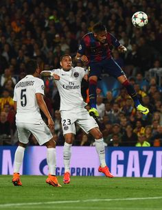 Neymar of Barcelona outjumps Marquinhos (5) and Gregory van der Wiel of PSG (23)during the UEFA Champions League Quarter Final second leg match between FC Barcelona and Paris Saint-Germain at Camp Nou on April 21, 2015 in Barcelona, Catalonia.