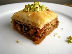 Baklava is a Greek rich, sweet pastry made of layers of filo pastry filled with chopped nuts and sweetened with a syrup made of honey. Baklava is prepared in large trays and cut into diamonds or triangles, the most common shapes. It is the most popular Greek dessert!