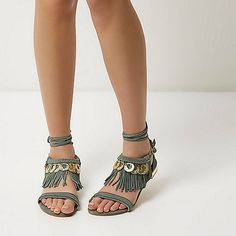 Leather Open toe Plaited straps Lace-up ankle Buckle fastening Tassel trim Gold tone coin trim