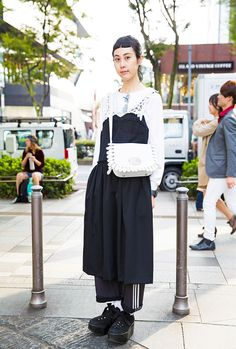 Yama works at the iconic Harajuku footwear brand Tokyo Bopper. She was wearing a layered black and white outfit when we street snapped her in Harajuku...
