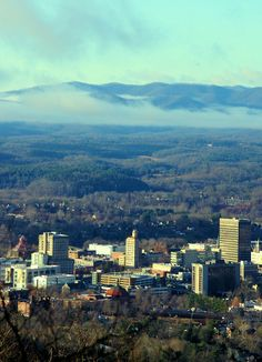 Downtown #Asheville skyline on a beautiful winter morning - with the Blue Ridge Mountains