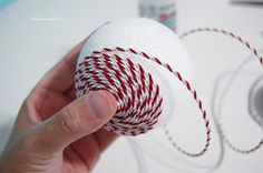 Christmas Ornaments Using Styrofoam Balls | Add glue here and there as you go to secure the trim.