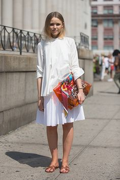 The Unexpectedly Necessary Statement Item You Probably Don't Own (Yet) #refinery29  http://www.refinery29.com/avant-garde-white-shirts#slide1  A knife-crisp poplin shirt looks great with a pleated skirt in a similar vibe.