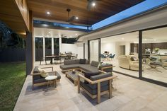 Our North Lakes entertainment area design resulted in a more open-planned approach to the living space at the rear of the home. Indoor Outdoor, Outdoor Living, Outdoor Decor, Entertainment Room, Outdoor Entertainment Area, Jellyfish Entertainment, Wedding Entertainment, Tv Decor, Home Decor
