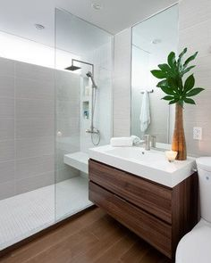 Bathroom Design, Cool Contemporary Bathroom From Modern Bathroom Designers Also Modern Wooden Vanity And Modern White Sink And Faucet Also Modern Mirror Without Frame Also Unique Bouquet Also Light Gray Tiling Wall: Cool Minimalist Bathroom Designs for Sm Ensuite Bathrooms, Laundry In Bathroom, Bathroom Renos, Bathroom Interior, Washroom, Bathroom Ideas, Small Bathrooms, Bathroom With Wood Floor, Bathroom With Window