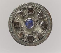 6th C. Disk Brooch Silver, wire, copper alloy rim, paste cabochons or stone, remnant of iron pin Dimensions: Overall: 1 1/8 x 3/8 in. (2.9 x 1 cm)