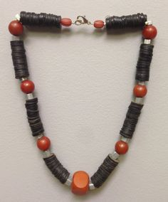 This a an African Amber necklace with unique African vinyl discs, beautiful Buri Nut Beads from Indonesia and African Masai aluminum cube beads. A