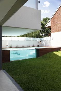 Devoto House / Andres Remy Arquitectos Acrylic window. Pinned to Pool Design by Darin Bradbury.