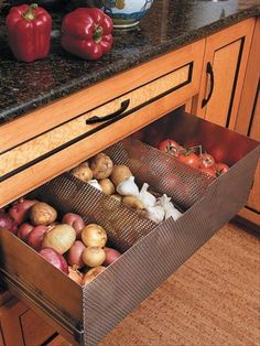 "Onion, garlic and potato storage built into your cabinetry. Perfect idea for an island drawer right below your ""cutting board area"". :)"