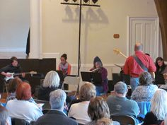 Tamarack Ensemble performing for grandparents on Grandparents Day.
