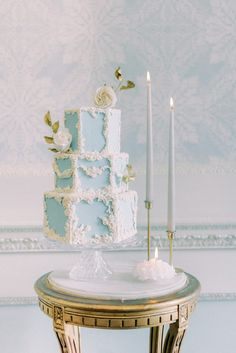 three tier rococo themes pale blue and white wedding cake with white rose and gold sugar flowers; two tapered ester and erik candles on vintage brass candle holders; antique side table circular with carved wood details; pale blue floral wallpaper and daido rail | Photo by London and Newcastle UK based light bright and airy Filipina wedding photographer Cristina Ilao Fall Wedding Cakes, Wedding Cakes With Cupcakes, Wedding Desserts, Spring Wedding, Wedding Blog, Wedding Ideas, Crystal Cake Stand, Country Wedding Inspiration, Beautiful Wedding Venues