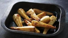 A generous glug of maple syrup makes all the difference in Nigella Lawson's easy roast parsnips recipe.