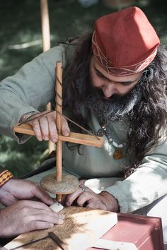 Viking reenactor working with a traditional drill. http://www.deviantart.com/art/Viking-at-work-156796177