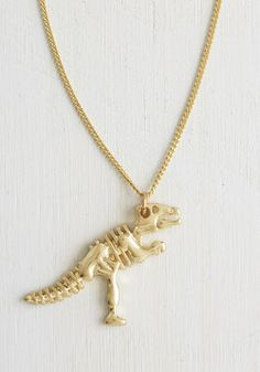 I Dig It Necklace. First things fossil - button your khaki safari dress over your figure, dust off your vintage Oxfords, and lobster-clasp this long Tyrranosaurus necklace over your geological-chic outfit. #gold #modcloth