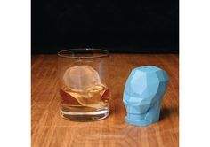 """Add some flair and chill to your drink!  Forget the boring ice cubes, this two part plastic mold makes a large skull block to cool down your drink.  Simple to fill and remove, the skull ice cube measures 3"""" x 3"""" and won't melt as quickly as regular ice cubes to dilute your drink.  Ideal for chilling whiskey."""