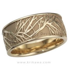 This is the matching men's wedding band to the Tree of Life Engagement Ring. A similar branch pattern repeats and overlaps around this ring. The recesses can be darkened to create contrast between the tree and background. - This yellow gold wedding band is 10mm wide.