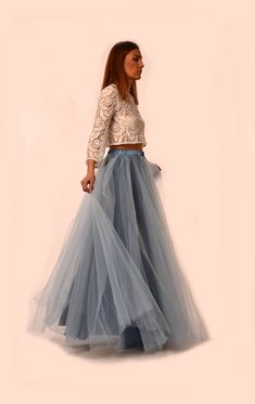 Beautifull, flattering tulle skirt in light blue colour, with contrast lining. Our tulle skirts are made of soft luxury tulle , cut in full circle, a design that is avoiding too much puffiness around the waist and creating enough volume and flair around the hem. This style of skirt is with elastic