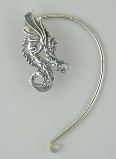 A Special Dragon Ear Wrap in Sterling Silver. Why Be Ordinary? This Fits the Left Ear Best. The Silver Dragon- Ear Wraps, http://www.amazon.com/dp/B00609CBJS/ref=cm_sw_r_pi_dp_8N03qb1M538P4