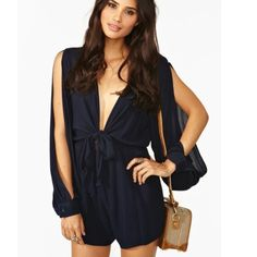 """HP Finders Keepers Buckets of Rain Romper Amazing navy romper featuring a plunging tie top and slit sleeves. Hip pockets, stretch panel at waist. Partially lined. Looks awesome paired with a chunky cocktail ring and platforms! By Finders Keepers.  *Shell: 100% Viscose; Lining: 100% Polyester  *30.5'' length  *3"""" inseam  *24.5"""" sleeve length Finders Keepers Other"""
