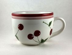 Love Cherries? This Large Mug is a great treat for a big cup of coffee, hot cocoa or soup!  - Made in China for Home Brands.  - Cup is 4 3/4 inches wide from side to side and 3 1/2 inches tall.  - Done in red and white with red stripes around the top.  - Red cherries on stems cover all sides.  - Dishwasher and Microwave safe.  - Not oven safe.  - Some minor paint chips