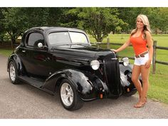 '36 Chevrolet....um this one is in my top 5, its sleek, I love the color, its got a great look.....oh and the girl is cute too :)
