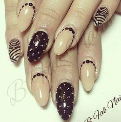 Black and nude stiletto nails @Cristine Strickland Strickland Strickland Schafer Borstel