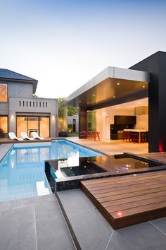 Amazing Swimming Pools Melbourne Best for Your Pool Design Inspirations: Futuristic Chaise Lounge Chairs Around Large Swimming Pools Melbourne Square Jacuzzi With Dark Mosaic Tile Glaring Ceiling Light ~ SFXit Design Pool Inspiration