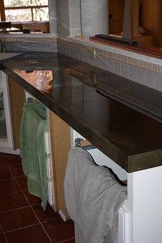 Pour concrete counter top over existing counter.
