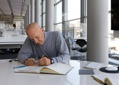 Norman Foster portrait in his office