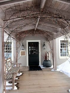deck / entry way / overhang with grape vines and twinkle lights