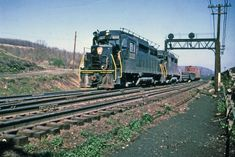 A pair of PRR at an unk. The were the last diesels that came with trainphone antennae for the PRR Pennsylvania Railroad, Locomotive, Trains, Diesel, Purpose, Cars, Photos, Vintage, Diesel Fuel