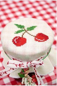 Cute idea: cross stitch your preserve toppers!