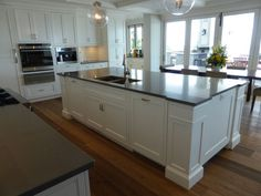 white kitchen island. Cabinetry by Wesley Ellen.