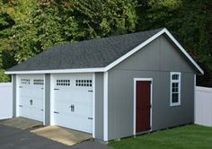 Detached two car garage - separate garage doors, entry and window