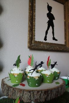 Peter Pan Birthday Party cupcake toppers This listing includes one of each four characters and eight mulitcolored feathers as shown. Characters include: Peter, Wendy, John and Michael. Feathers come in two shades of green and red. Each topper is approximately 2 inches in size and connected to toothpicks.