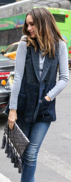 Street Style, March 2015: Louise Roe is wearing a Marissa Webb vest, a pale grey Reiss sweater and a pair of denim Sass and Bide jeans
