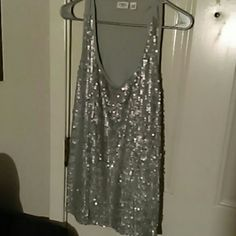 SILVER SLEEVELESS SEQUIN BLOUSE NWOT, NEVER WORN..SILVER SPARKLY SEQUINS, NONE MISSING, NONE BENT OR TORN, EXCELLENT CONDITION. BACK OF BLOUSE HAS NO SEQUINS BUT SILKY SOFT FABRIC. WEAR WITH SHORT SHORTS WHITE WITH BLACK WEDGES. OR SHORT KNEE LENGTH PENCIL SKIRT! AWESOME POSSIBILITIES! USE YOUR UNIQUE STYLE AND CREATE A WOW! LOOK! Cato Tops Blouses